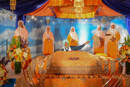 Los Angeles, CA, USA - April 5, 2015: Devotee Sikhs recite prayers at the Anniversary of Baisakhi celebration.