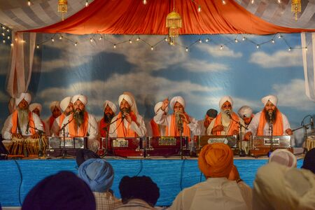 recite: Los Angeles, CA, USA - April 5, 2015: Devotee Sikhs recite prayers at the Anniversary of Baisakhi celebration.