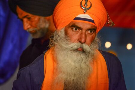 sikh: Los Angeles, CA, USA - April 5, 2015: Devotee Sikh with orange turban at the Anniversary of Baisakhi celebration.