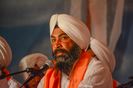 devotee: Los Angeles, CA, USA- April 5, 2015: Devotee Sikh with white turban at the Anniversary of Baisakhi celebration. Editorial