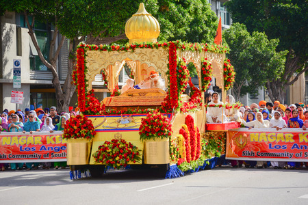 devotee: Los Angeles, CA, USA - April 5, 2015: Devotee Sikhs marching behind a float at the Anniversary of Baisakhi celebration.