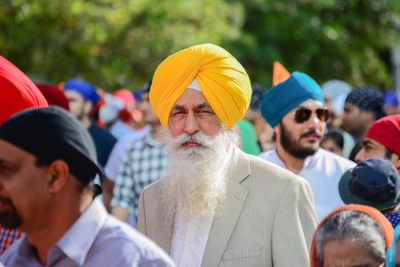 devotee: Los Angeles, CA, USA - April 5, 2015: Devotee Sikh with yellow turban marching at the Anniversary of Baisakhi celebration.
