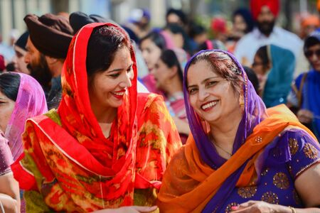 Los Angeles, CA, USA - April 5, 2015: Devotee Sikhs women smiling and  marching at the Anniversary of Baisakhi celebration. Editorial