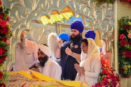 recite: Los Angeles, CA, USA - April 5, 2015: Devotee Sikh recite prayers at the Anniversary of Baisakhi celebration.