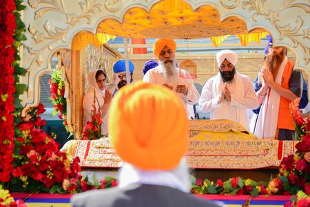 recite: Los Angeles CA USA  April 5 2015: Devotee Sikhs recite prayers at the Anniversary of Baisakhi celebration. Editorial