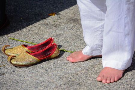 devotee: Los Angeles CA USA  April 5 2015: Devotee Sikh praying without shoes at the Anniversary of Baisakhi celebration.