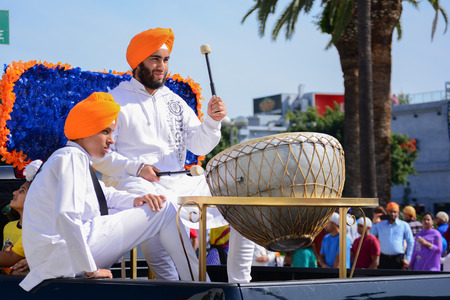 sikh: Los Angeles CA USA  April 5 2015: Devotee Sikh beating a drum at the Anniversary of Baisakhi celebration.
