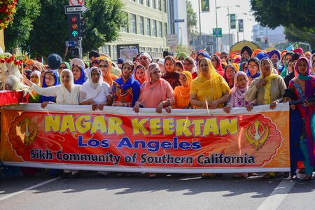 devotee: Los Angeles CA USA April 5 2015: Devotee Sikhs marching at the Anniversary of Baisakhi celebration.