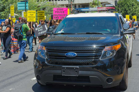 arrests: Los Angeles CA USA  May 02 2015: Police watching Protestants during march against the death of Freddie Gray a man of Baltimore who was seriously injured in police custody.