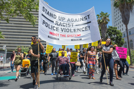 resulted: Los Angeles CA USA  May 02 2015: Group with banners and posters during march against the death of Freddie Gray a man of Baltimore who was seriously injured in police custody.