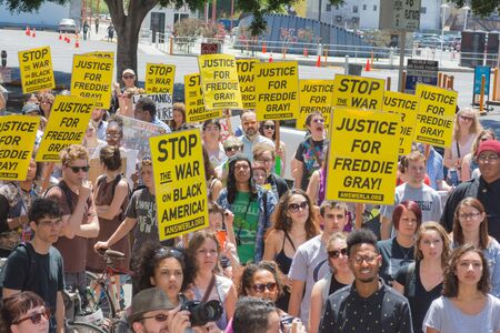in custody: Los Angeles CA USA  May 02 2015: Group of people holding signs during march against the death of Freddie Gray a man of Baltimore who was seriously injured in police custody.