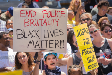 arresting: Los Angeles CA USA  May 02 2015: Woman holding sign during march against the death of Freddie Gray a man of Baltimore who was seriously injured in police custody. Editorial