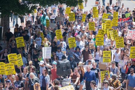 arrests: Los Angeles CA USA  May 02 2015: Protestants in the streets with signs during march against the death of Freddie Gray a man of Baltimore who was seriously injured in police custody. Editorial