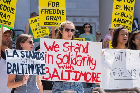 resulted: Los Angeles CA USA  May 02 2015: Group of people holding signs during march against the death of Freddie Gray a man of Baltimore who was seriously injured in police custody.
