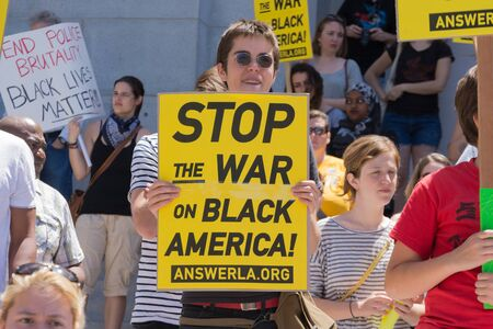 arrests: Los Angeles CA USA  May 02 2015: Woman holding sign during march against the death of Freddie Gray a man of Baltimore who was seriously injured in police custody. Editorial