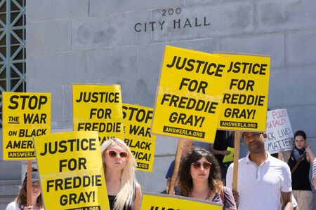 arrests: Los Angeles CA USA  May 02 2015: Group of people holding signs during march against the death of Freddie Gray a man of Baltimore who was seriously injured in police custody.