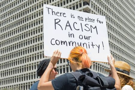 arrests: Los Angeles CA USA  May 02 2015: Woman raising a sign in march against the death of Freddie Gray a man of Baltimore who was seriously injured in police custody.