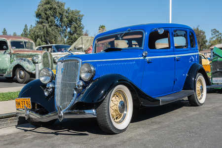 luxe: Van Nuys, CA - USA - September 20, 2015:  Ford Model 40 730 De Luxe Fordor Sedan 1934 on display at The 4th Annual Galpin Car Show.