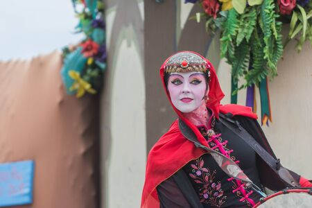 painted face: Irwindale, CA - USA - May 07, 2016: Artist performing with painted face during The 54th Annual Renaissance Pleasure Faire.