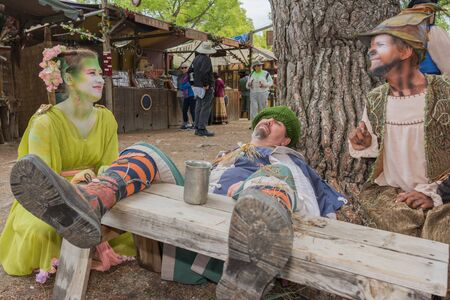 drunkenness: Irwindale, CA - USA - May 07, 2016: Man with medieval costume lying simulating drunkenness during The 54th Annual Renaissance Pleasure Faire. Editorial