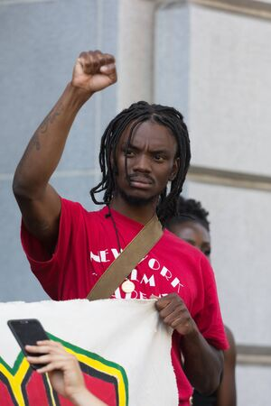 protestor: Los Angeles, USA - July 12, 2016 -  Black lives matter protestor during march on City Hall following ruling on LAPD fatal shooting of African American female Redel Jones