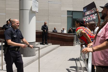 occupy movement: Los Angeles, USA - July 12, 2016 -  Black lives matter protestors and police during march on City Hall following ruling on LAPD fatal shooting of African American female Redel Jones