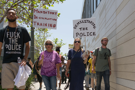 protestors: Los Angeles, USA - July 12, 2016 -  Black lives matter protestors holding a poster during march on City Hall following ruling on LAPD fatal shooting of African American female Redel Jones
