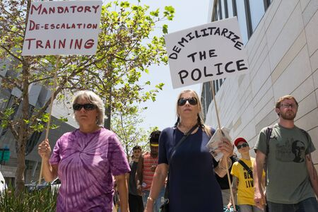 occupy movement: Los Angeles, USA - July 12, 2016 -  Black lives matter protestors holding a poster during march on City Hall following ruling on LAPD fatal shooting of African American female Redel Jones