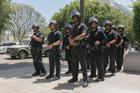fatal: Los Angeles, USA - July 12, 2016 - Officers during march on City Hall following ruling on LAPD fatal shooting of African American female Redel Jones