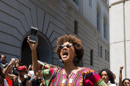 fatal: Los Angeles, USA - July 12, 2016 -  Black lives matter protestor shouting during march on City Hall following ruling on LAPD fatal shooting of African American female Redel Jones Editorial