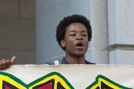 occupy movement: Los Angeles, USA - July 12, 2016 -  Black lives matter protestor speaking during march on City Hall following ruling on LAPD fatal shooting of African American female Redel Jones Editorial