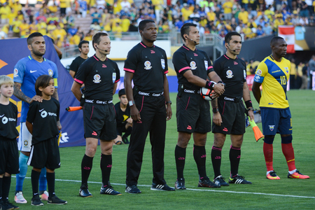 arbitros: Pasadena, USA - June 04, 2016: Fifa referees during Copa America Centenario match Brazil vs Ecuador at the Rose Bowl Stadium.