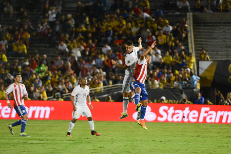 collide: Pasadena, USA - June 07, 2016: Soccer players collide in the air during Copa America Centenario match Colombia vs Paraguay at the Rose Bowl Stadium.