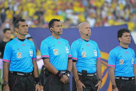 arbitros: Pasadena, USA - June 07, 2016: Referees during national anthem during Copa America Centenario match Colombia vs Paraguay at the Rose Bowl Stadium.