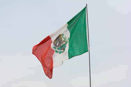 Irwindale, USA - March 4, 2017: Mexican flag weaving on sky background on display during 742 Race Wars at the Irwindale Speedway.