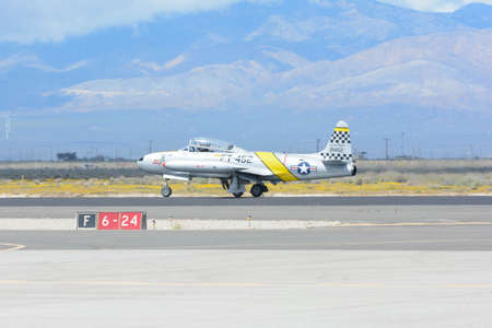 Lancaster, USA - March 25, 2017: Greg Wired Colyer is taxiing an a Lockheed T-33 Shooting Star  during Los Angeles County Air Show at the William J Fox Airfield.