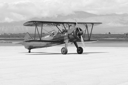 Lancaster, USA - March 25, 2017: Vicky Benzing taxiing her 1940 Boeing Stearman during Los Angeles County Air Show at the William J Fox Airfield.
