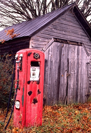 An old rustic gas pump sits idly by  photo