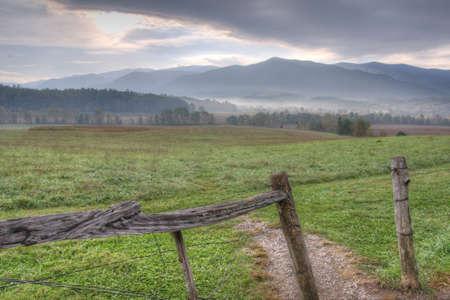 split rail: Open fields, fog, and split rail fences of Cades Cove  Stock Photo