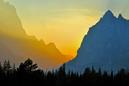 sneaks: Sunset color sneaks between the peaks of The Grand Tetons
