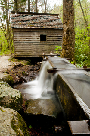 gristmill: A water trough leads to an old historic mill  Stock Photo