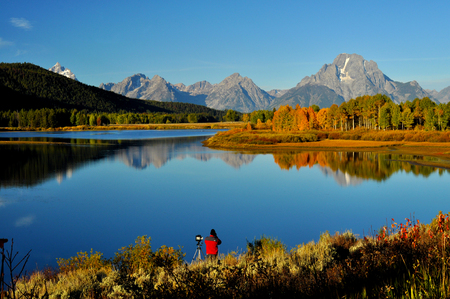 Photographer in early morning light at Oxbow Bend in the Grand Tetons  photo