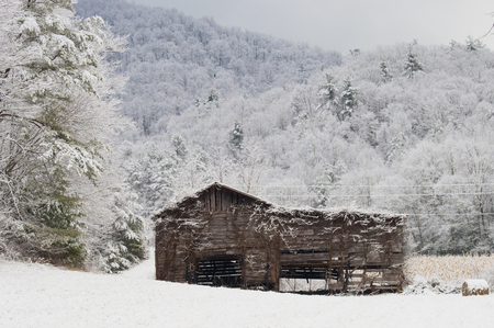 Country barn surrounded by snow  photo