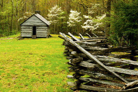 split rail: An old split rail fence leads to an old shed  Editorial