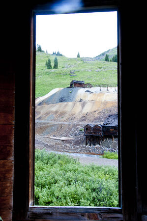 old mining building: Window in an old ghost town in Colorado  Stock Photo