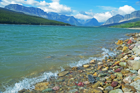 Beautiful clear lake waters in Glacier National Park. photo