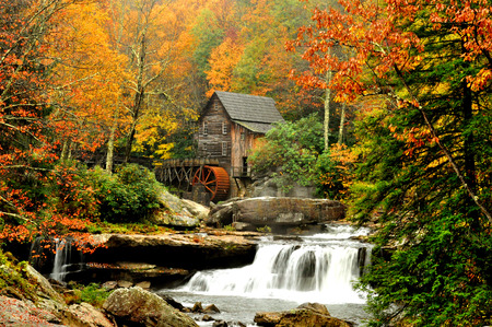 Old mill and waterfall in fall, Glades Grist Mill.