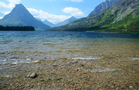 Clear blue lake in Glacier National Park. photo