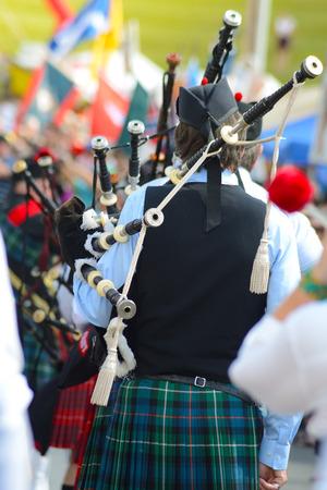 スコッツ-アイルランド フェスティバル バグパイプ演奏されています。 写真素材