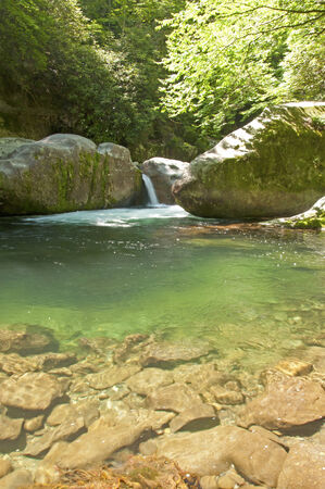 great smokies: Small waterfall beside cool clear waters. Stock Photo